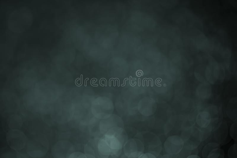 Bokeh water dot tone blue for background. Abstract light dark flare design black texture wallpaper holiday bright space macro celebration shiny reflection stock photo