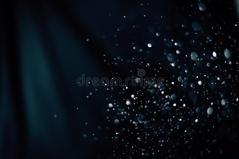 Bokeh of water fly and lights on black and blue background,abstract background all colors bokeh circles for background. royalty free stock photos