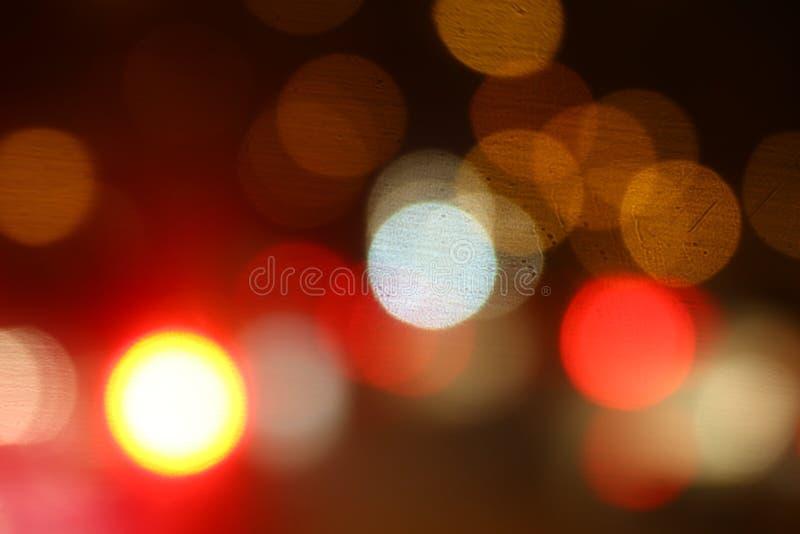 Bokeh wielo- barwionego abstrakcjonistycznego miękkiego kolorowego lekkiego bokeh tła nocy światła czerwony żółty tło zdjęcie stock