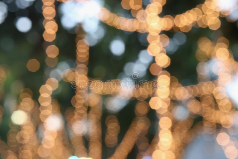 bokeh of yellow light hanging on tree in garden royalty free stock photos