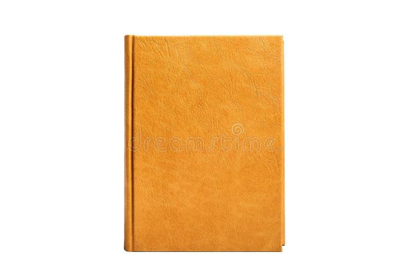 Boken är i en ljus brun hård läderräkning royaltyfria bilder