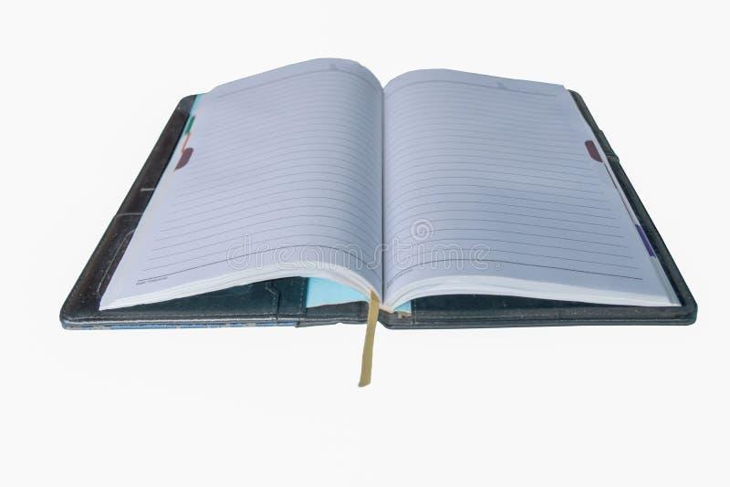 Boken öppnar i den vita bakgrunden royaltyfri foto