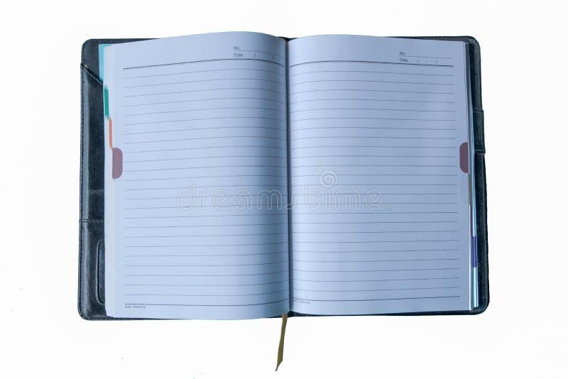 Boken öppnar i den vita bakgrunden royaltyfria foton