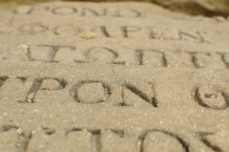 Bokstäver på stenen fotografering för bildbyråer