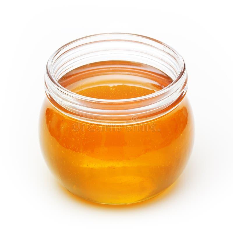 Bol en verre avec du miel photo libre de droits