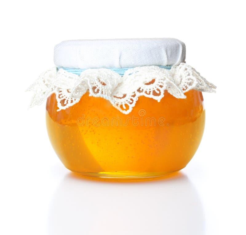 Bol en verre avec du miel images stock