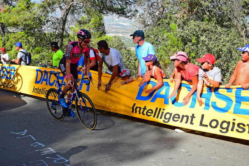 Bol Jeste Cheered On By The Crowd La Vuelta España Cycle Race. The crowd applauding the rider near the mountain top finish in the 2017 La Vuelta Espana bike stock image