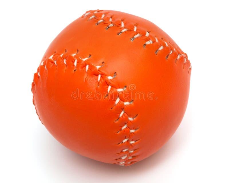 bola anaranjada del béisbol en el fondo blanco fotografía de archivo
