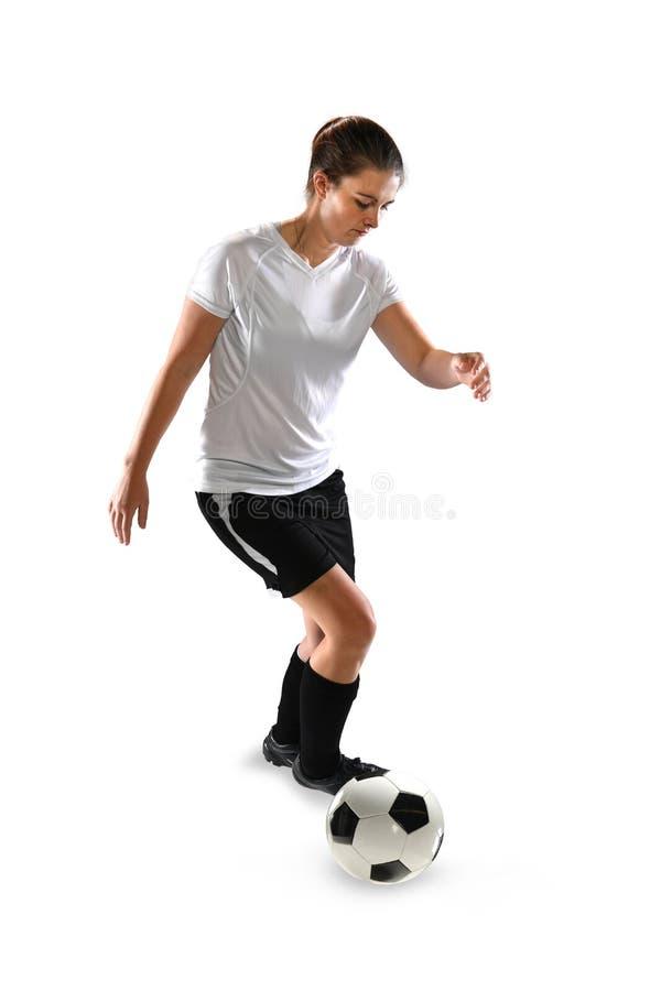 Bola de controlo fêmea do jogador de Soccel imagens de stock