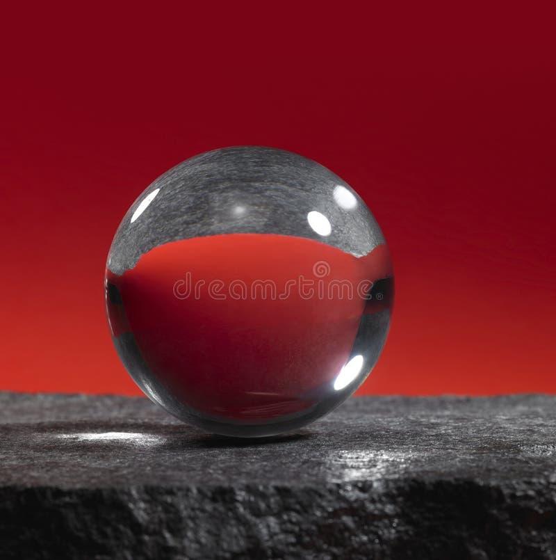 Bola de cristal na superfície da pedra imagem de stock royalty free