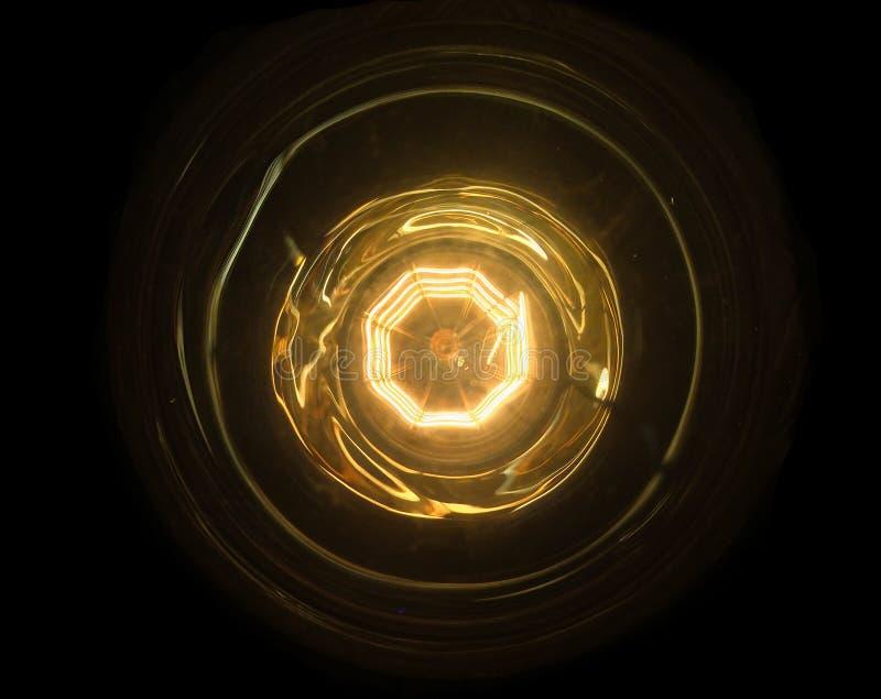 Bola de fogo abstrata com o núcleo interno e o anel Conceito de fonte de energia da tecnologia Feche acima sob a ampola imagem de stock royalty free