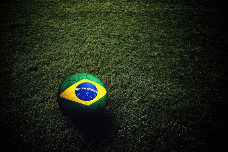 Bola de futebol com bandeira de Brasil fotografia de stock royalty free
