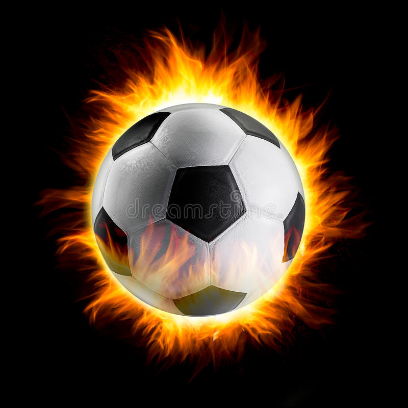 Bola de futebol com fogo foto de stock