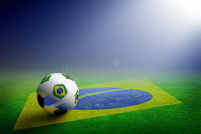 Bola de futebol e bandeira de Brasil fotografia de stock royalty free