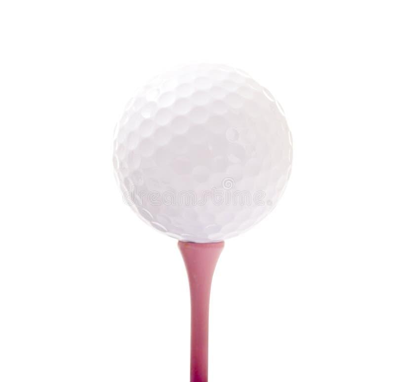 Bola de golfe no T cor-de-rosa fotos de stock royalty free