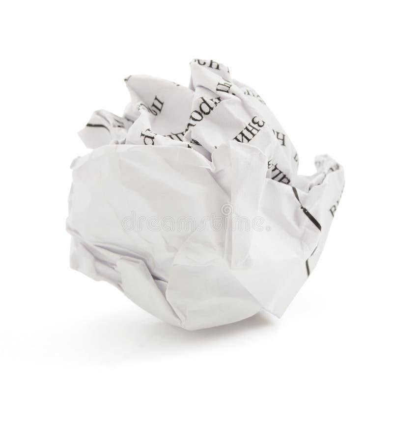 Bola de papel arrugada en blanco imagen de archivo