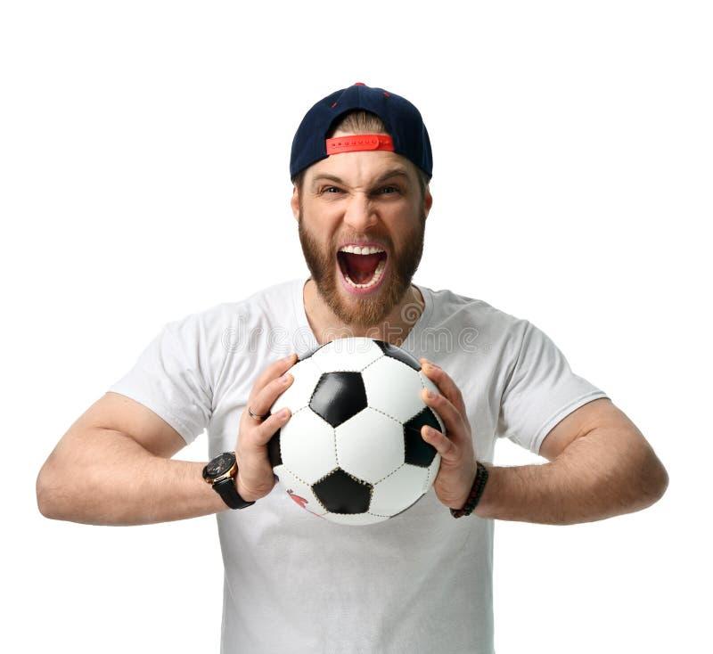 Bola del control del hombre del aficionado al fútbol que celebra el griterío de grito de risa feliz hacia fuera ruidosamente en e fotos de archivo