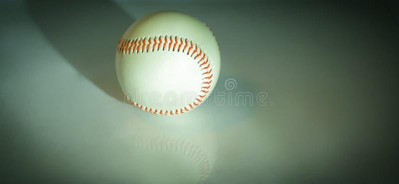 Bola do basebol com pontos vermelhos Isolado em um branco fotografia de stock
