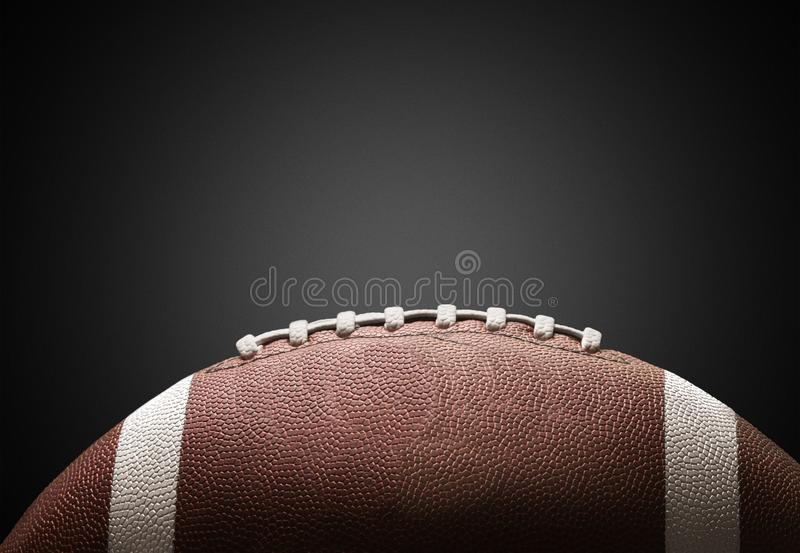 Bola do futebol americano no fundo foto de stock royalty free