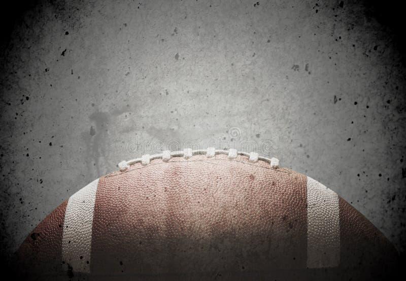 Bola do futebol americano no fundo escuro fotografia de stock