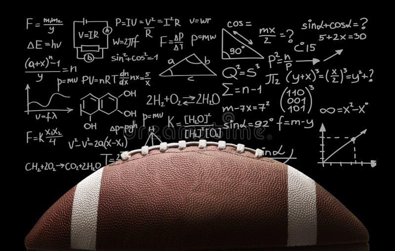 Bola do futebol americano no fundo do quadro foto de stock royalty free