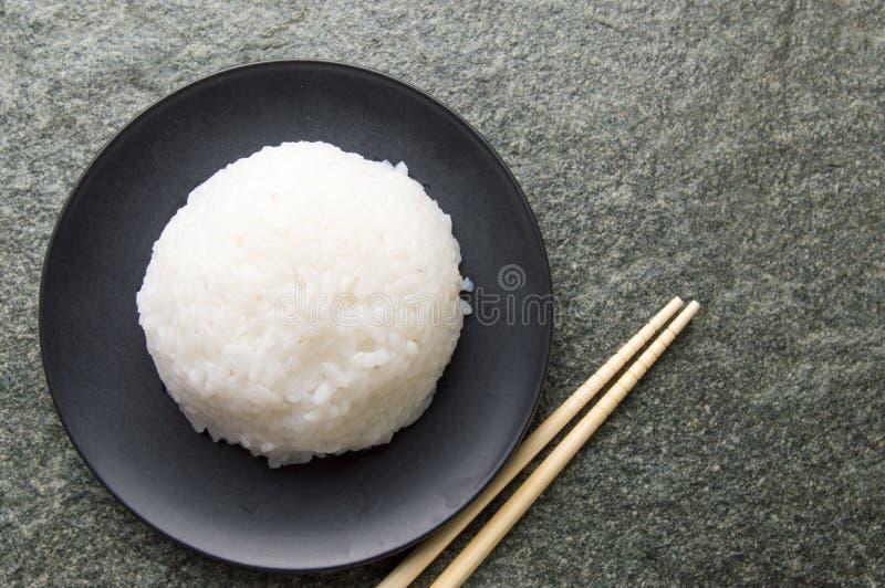 Bola e hashis de arroz foto de stock