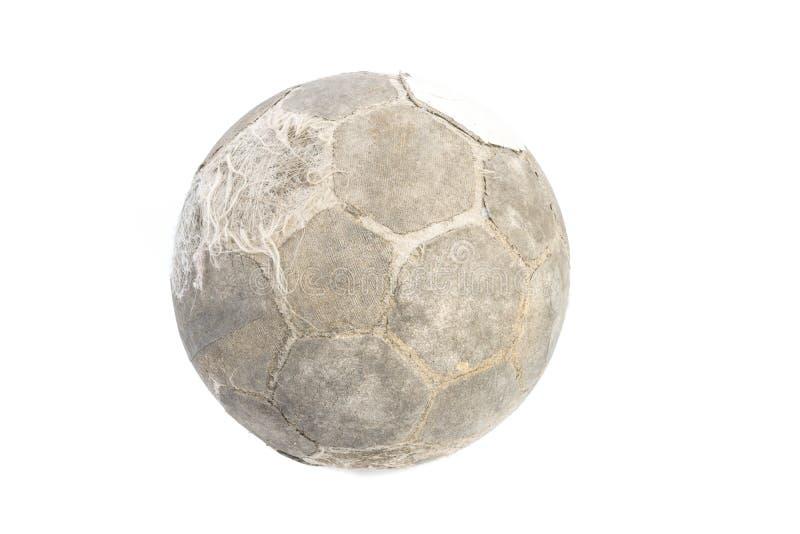 Bola muy vieja para el fútbol aislada fotos de archivo libres de regalías