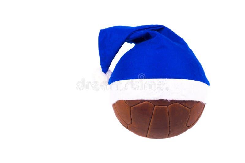 Bola velha do couro do futebol em um fundo branco fotografia de stock