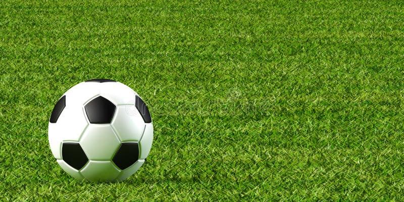 Bola y césped de fútbol foto de archivo