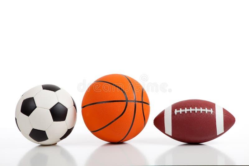 Bolas clasificadas de los deportes en blanco imagenes de archivo