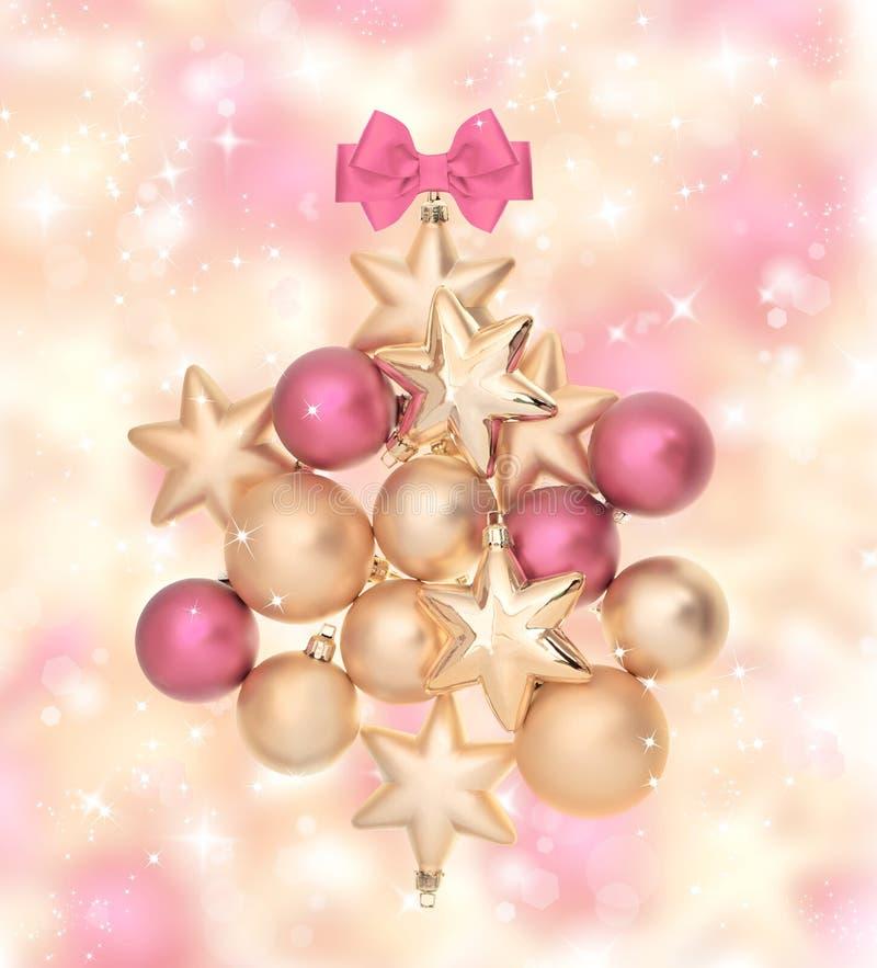 Bolas cor-de-rosa e douradas com luzes mágicas fotografia de stock