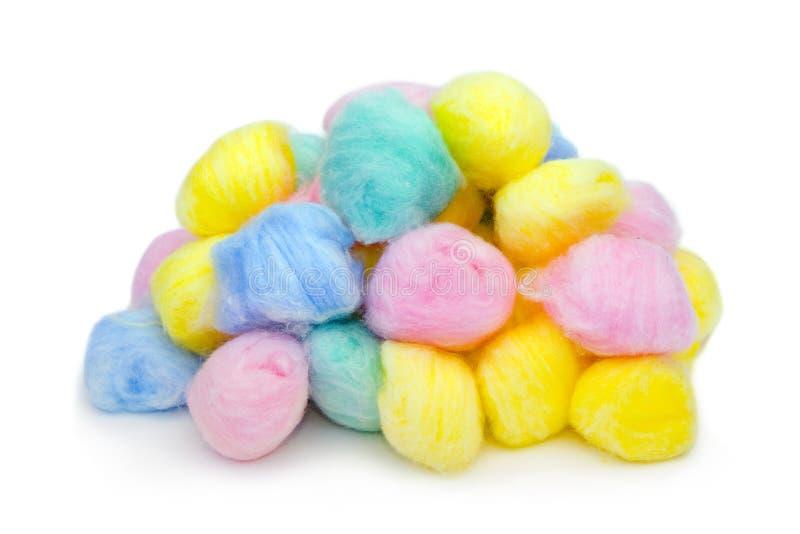 Bolas de algodón multicoloras imagenes de archivo