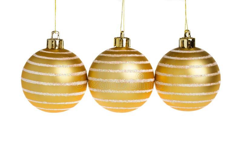Bolas de oro de la Navidad imagen de archivo