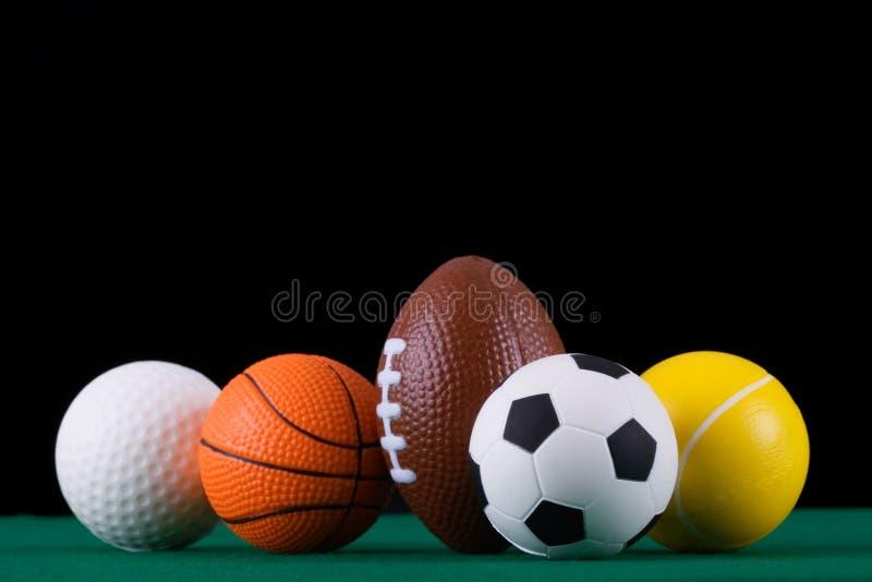Bolas miniaturizadas del deporte   imagen de archivo