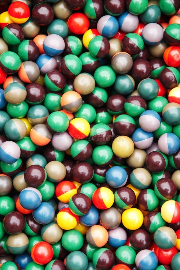 Bolas multicoloras del punto negro del Paintball foto de archivo libre de regalías