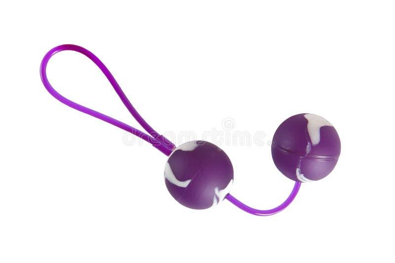 Bolas púrpuras y blancas del juguete del sexo - del amor fotografía de archivo