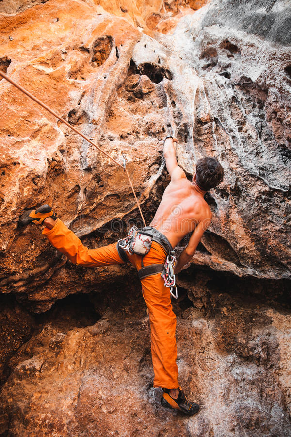 Bold choice - rock climbing stock photography