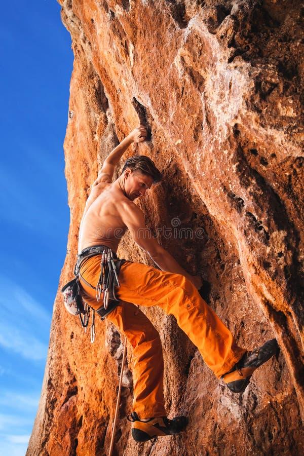 Bold choice - rock climbing stock images