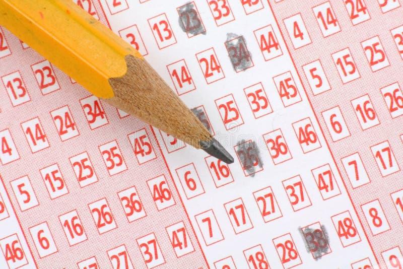 Boleto y lápiz de lotería imagen de archivo