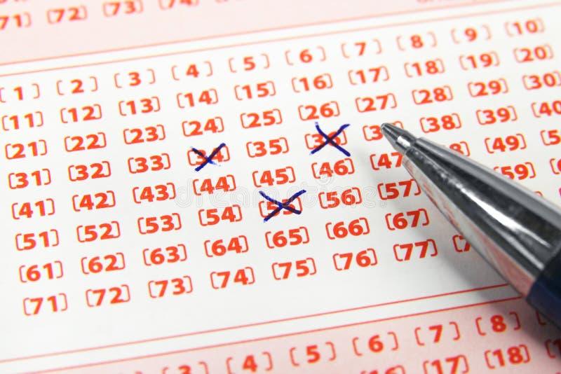 Boleto y pluma de lotería imagen de archivo