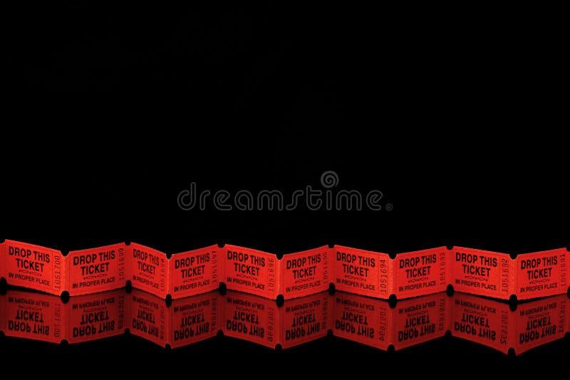 Boletos rojos en negro foto de archivo