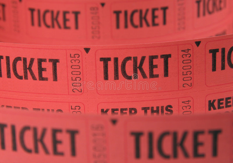 Boletos rojos en un rodillo imagen de archivo libre de regalías