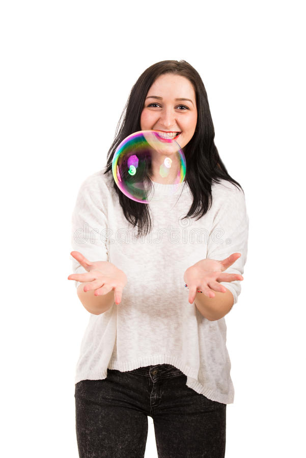 Bolha de sabão grande de riso da captura da mulher imagens de stock royalty free