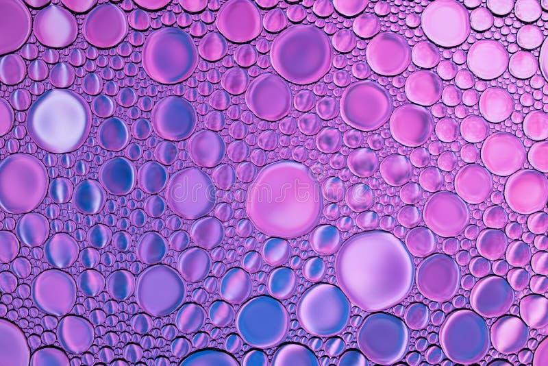 Bolhas ou backgroundÑŽ abstrato brilhante das gotas da água imagem de stock
