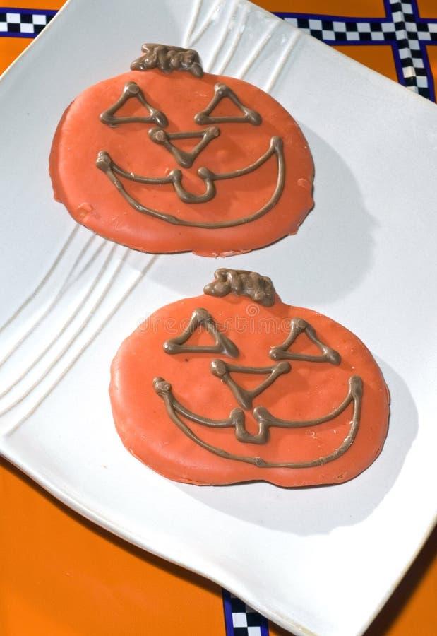Bolinhos de Halloween da abóbora foto de stock