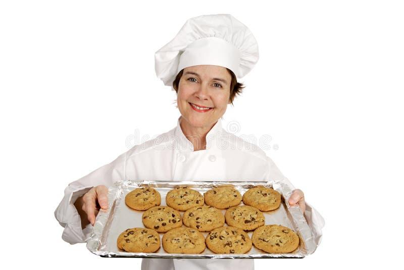 Bolinhos de microplaqueta do cozinheiro chefe & de chocolate imagem de stock