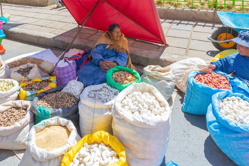 Bolivia La Paz selling potatoes to the El Alto market royalty free stock photos