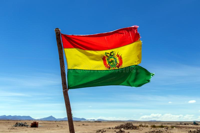 Bolivian Flag waving in the wind against blue sky background stock photos