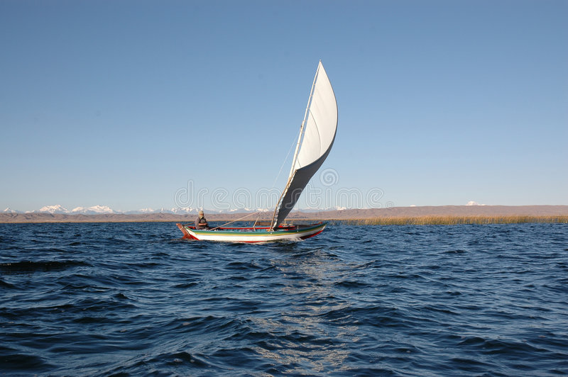 Bolivian sailing. Boat at the lake titikaka with the andes in the background stock photos