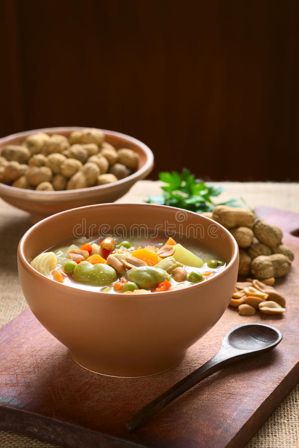 Bolivian Sopa de Mani (Peanut Soup). Bowl of traditional Bolivian Sopa de Mani (peanut soup) made of meat, pasta, vegetables (pea, carrot, potato, broad bean stock photos